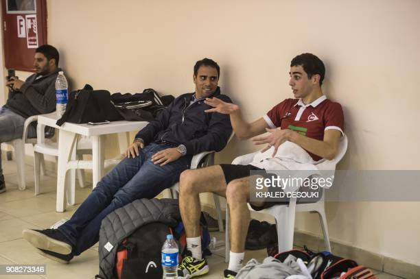 Egyptian world No 3 squash player Ali Farag chats with former Squash player world No 1 Karim Darwish during a training session in Wadi Degla sports...