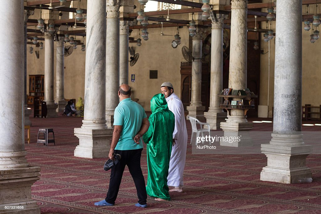 Egyptian worshippers enter Amr ibn al-Aas Mosque for prayers