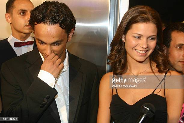 Egyptian young film stars Ahmad Yahya and Yusra Lawzi arrive at a movie theatre in Cairo 22 August 2004 to attend the premiere of Youssef Chahine's...