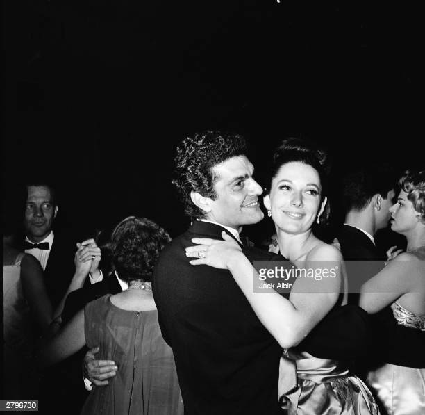 Egyptian-born actor Omar Sharif dances with Sue Barton at the Academy Award after party in Los Angeles, California, April 8, 1963.