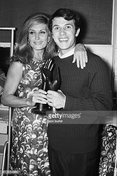 Egyptian-born French singer and actress Dalida gives the Bravo d'Or award to Belgian-Italian singer and songwriter Salvatore Adamo.