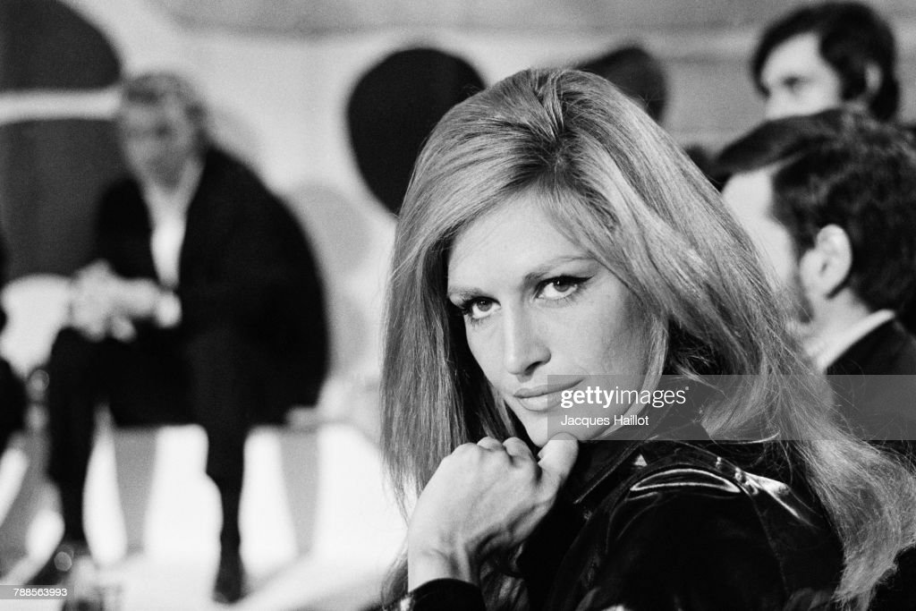 Egyptian-born French singer Dalida on the set of the TV Show Tele Dimanche, hosted by Raymond Marcillac.