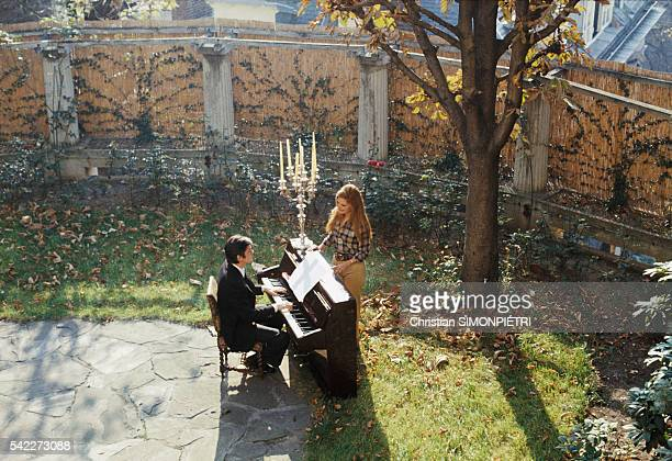 Egyptianborn Italian singer Dalida and French actor Alain Delon perform in a courtyard during the music video shoot for their duet Paroles Paroles