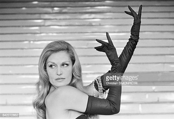 Egyptianborn Italian singer Dalida performs at the FoliesBergere during a stage adaptation of the 1946 film Gilda which originally starred Rita...