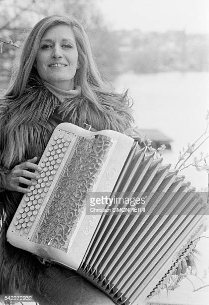 Egyptianborn Italian singer Dalida playing accordion