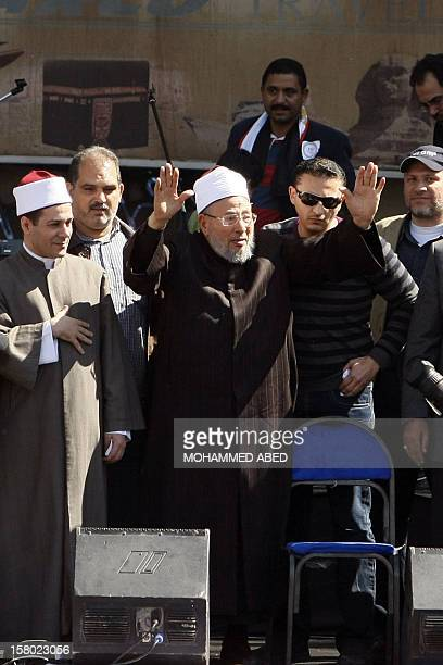 Egyptianborn Muslim cleric Sheikh Yussef alQaradawi greets the crowd at Cairo's central Tahrir square beforedelivering the Friday prayer sermon on...