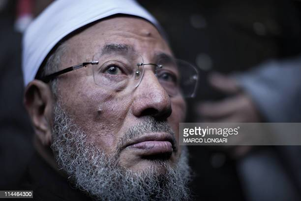 Egyptianborn Muslim cleric Sheikh Yussef alQaradawi joins the crowds on Tahrir square in Cairo on February 18 2011 where he delivered the Friday...