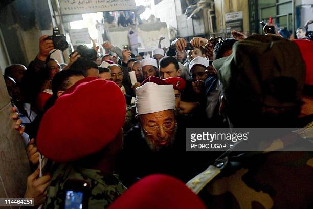 Egyptianborn Muslim cleric Sheikh Yussef alQaradawi leaves Cairo's central Tahrir square after delivering the Friday prayer sermon on February 18...