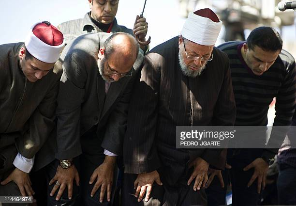 Egyptianborn Muslim cleric Sheikh Yussef alQaradawi prays at Cairo's central Tahrir square after delivering the Friday prayer sermon on February 18...