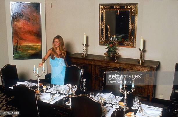 Egyptianborn singer Dalida lights the candles on her dinner table