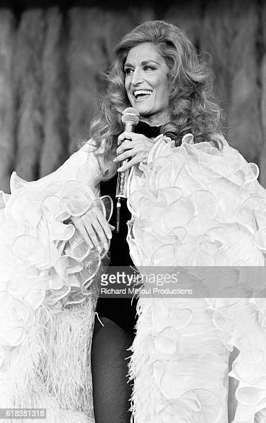 Egyptian-born singer Dalida performs at the Moulin Rouge on the occasion of the famous dance hall's 90th anniversary. Celebrities Jerry Lewis,...