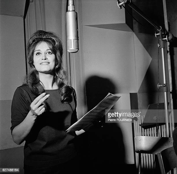 Egyptian-born singer Dalida rehearses and records at the Olympia concert hall.