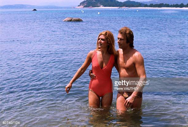 Egyptian-born singer Dalida wades through the Tyrrhenian Sea with her boyfriend along the shoreline in Porto-Vecchio, Corsica.