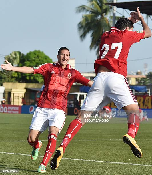 Egyptian's Al Ahly player Hassan Mahmoud Ibrahim celebrates a team goal on November 29 2014 at Robert Champroux stadium in Abidjan during their...