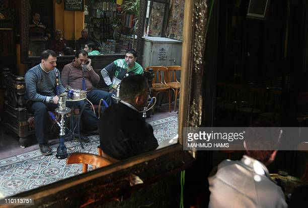 Egyptians and tourists smoke shisha and drink tea in the popular ElFishawi coffee shop in the tourist bazaar close to the AlHussein mosque in Cairo...