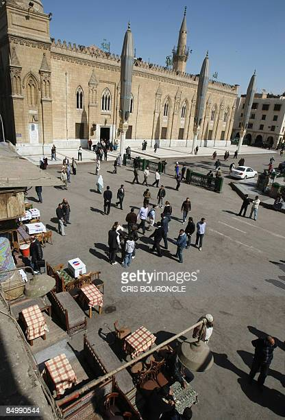 Egyptians and visitors pass the empty tables of restaurants in the plaza outside the AlHussein mosque close to the usually popular Khan alKhalili...