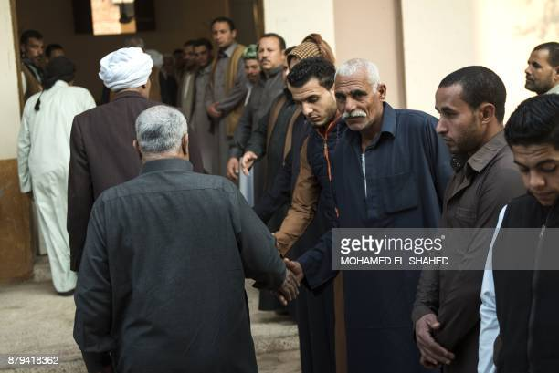 Egyptians attend on November 26 2017 in the village of Saud in the centre of alHusseiniya in the country's northern province of alSharqiya the...