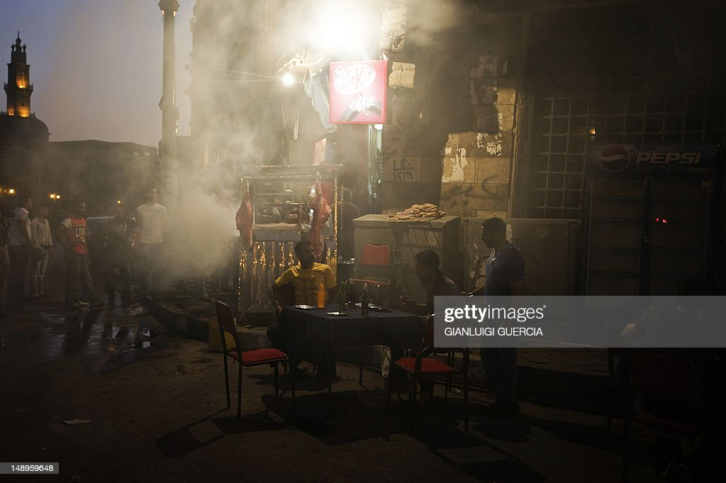 Egyptians break the fast outside al-Azhar mosque, in Cairo's Islamic neighbourhood, after attending evening prayers on the first day of the Muslim fasting month of Ramadan on July 20, 2012. Muslims fasting in the month of Ramadan must abstain from food, drink and sex from dawn until sunset, when they break the fast with the meal known as Iftar.