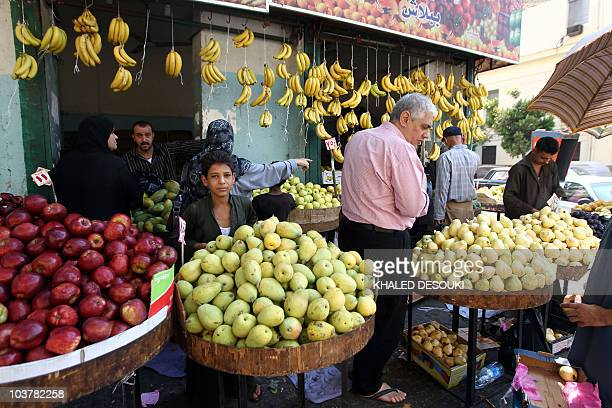 Egyptians buy fruits at a shop in downtown Cairo on August 20 2010 during Islam's holy fasting month of Ramadan Egyptians have been complaining from...