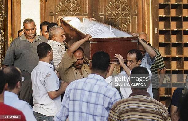 Egyptians carry the coffin of a Shiite man who was killed last night along with three others by a mob during a funeral in ElSayeda Nafisa Mosque in...