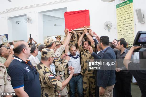 Egyptians carry the coffin of a soldier who was killed a day earlier in the restive Sinai Peninsula in an attack by the Islamic State group during a...