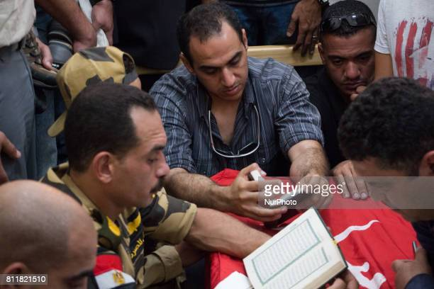 Egyptians carry the coffin of a soldier, who was killed a day earlier in the restive Sinai Peninsula in an attack by the Islamic State group, during...