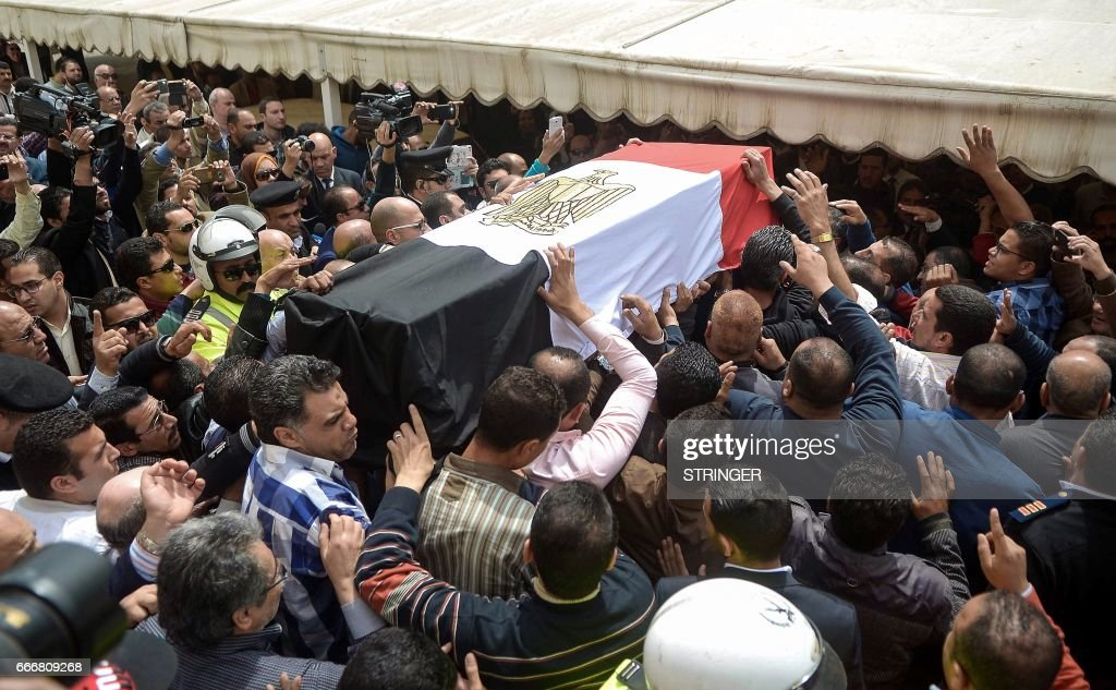 Egyptians carry the coffin of policewoman Brigadier Nagwa el-Haggar during her funeral on April 10, 2017, after she died during a blast that struck outside the Coptic Orthodox Patriarchate headquarters in the Mediterranean city of Alexandria on Palm Sunday the day before. Egypt prepared to impose a state of emergency after jihadist bombings killed dozens at two churches in the deadliest attacks in recent memory on the country's Coptic Christian minority. /