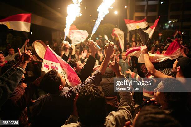 Egyptians celebrate Egypt's victory over Ivory Coast during the soccer African Cup February 10 2006 in Cairo Egypt Thousands of Egyptians gather...
