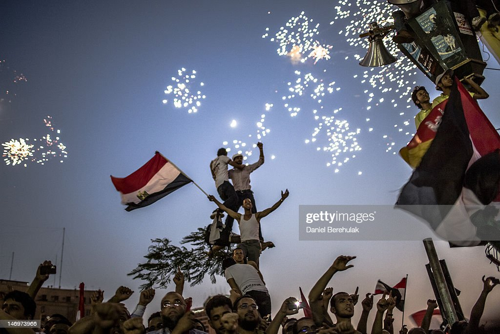 Egyptians celebrate the election of their new president Mohamad Morsi in Tahrir Square on June 24, 2012 in Cairo, Egypt. Official election results today confirmed that Mohamed Morsi is to be the next president of Egypt. Morsi received over 13 million or 51.7% of the votes, while his main rival, former Prime Minister Ahmed Shafiq, received 48.27 percent.