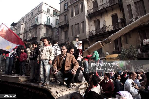 Egyptians celebrate in Tahrir Square by posing for photos with Army tanks on February 13 2011 in downtown Cairo Egypt