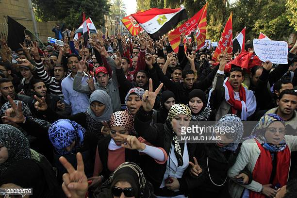 Egyptians chant slogans as thousands march in a protest from AlAhly club to the headquarters of the ministry of interior in Cairo on February 2 2012...