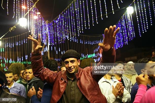 Egyptians dance during festivities marking 1445th anniversary of the birthday of Islam's Prophet Mohammed known in Arabic as alMawlid alNabawi in the...