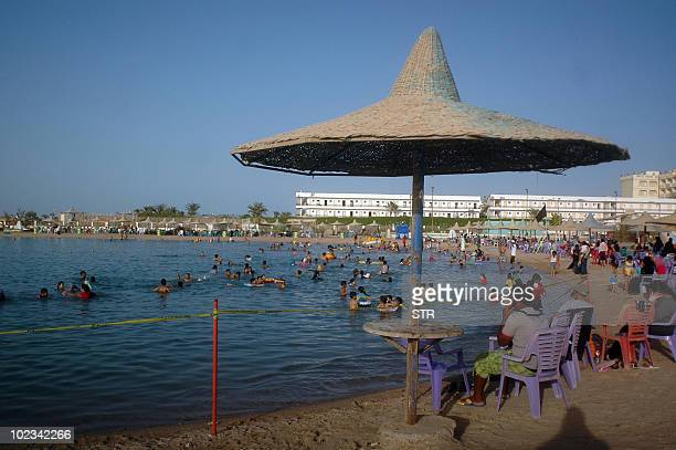Egyptians enjoy the public beach along the Red Sea resort of Hurghada in southern Egypt on June 23 which attacks hundreds of thousands of tourists...