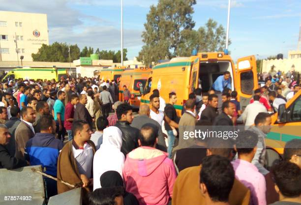 Egyptians gather around ambulances following a gun and bombing attack on the Rawda mosque near the North Sinai provincial capital of ElArish on...