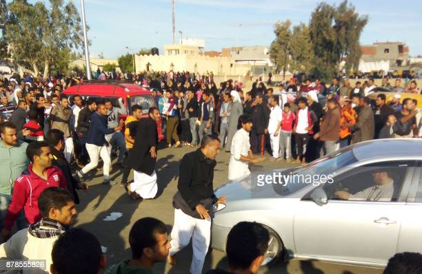 Egyptians gather at the site of a gun and bombing attack that targeted the Rawda mosque near North Sinai provincial capital of ElArish on November 24...