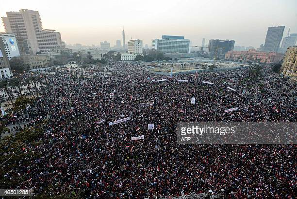 Egyptians gather in Cairo's Tahrir Square during a rally marking the anniversary of the 2011 Arab Spring uprising on January 25, 2014. A spate of...