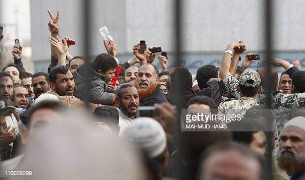 Egyptians gather waiting for the release of Abbud alZomor and his cousin Tareq members of Egypt's Islamic Jihad from Tura jail in Hilwan on the...