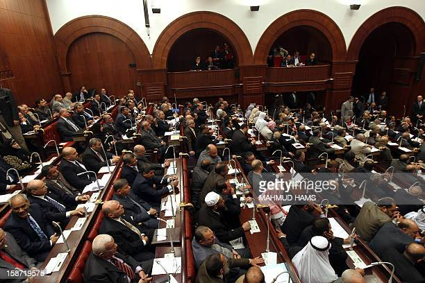 Egyptians members of the Shura Council the upper house of parliament where the Constituent Assembly drafted the country's new constitution meet on...