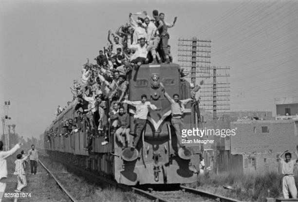 Egyptians overcrowd a train during President Gamal Abdel Nasser's funeral, Cairo, 28th September 1970.