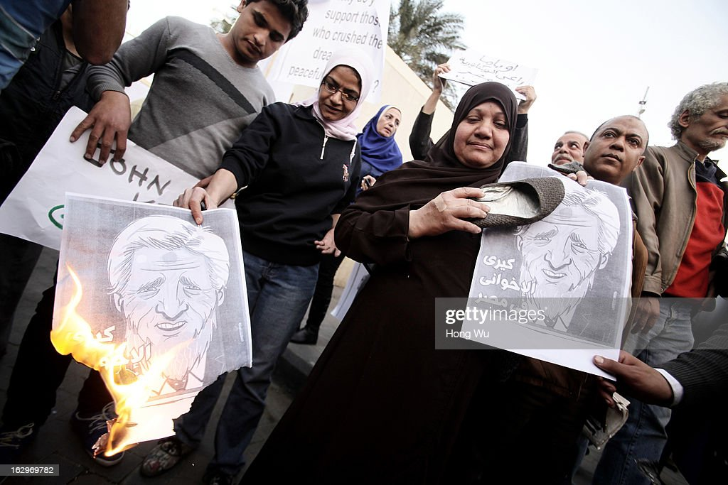 Egyptians protestors set pictures of U.S. Secretary of State John Kerry on fire during a march to the foreign ministry against Kerry and Egyptian President Mohamed Morsi on March 2, 2013 in Cairo, Egypt. The new U.S. Secretary of State is on his first trip, visiting nine nations in Europe and the Middle East.