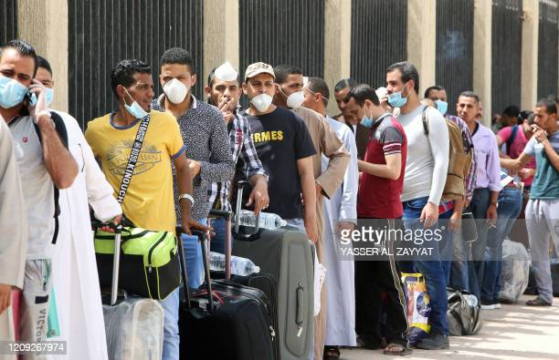 Egyptians queue up outside a school that was turned into a centre to receive residency violators wishing to avail an amnesty Kuwait announced for...