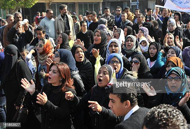 Egyptians rally on February 17 closing down government offices and factories in the Suez Canal city of Port Said as they demand justice for dozens of...