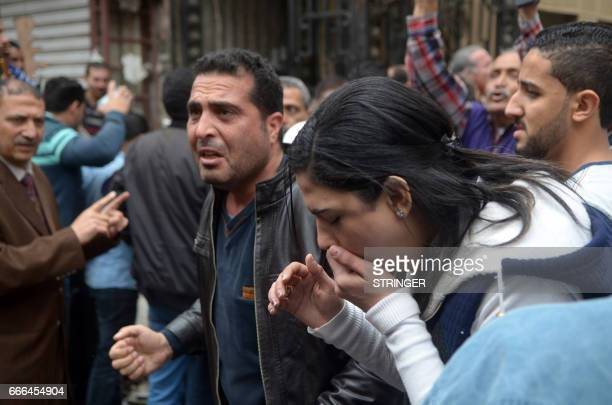 Egyptians react near a church in Alexandria after a bomb blast struck worshippers gathering to celebrate Palm Sunday on April 9 2017 The Interior...
