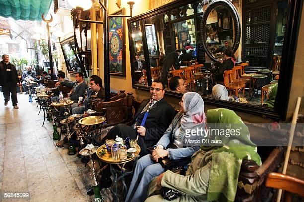 CAIRO EGYPT FEBRUARY 8 Egyptians seat in a cafe in the Khan alKhalili bazaar on February 8 2006 in Islamic Cairo Egypt The Khan is one of the largest...