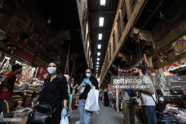 Egyptians shop at the roofed Khayamiya Street in the old city of the Egyptian capital Cairo on April 19 ahead of the Muslim holy month of Ramadan. -...