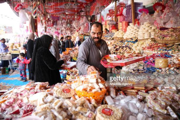 Egyptians shop for the preparations of the commemorating the birth of Muslims' beloved Prophet Muhammed known in Arabic as Mawlid alNabi in Cairo...