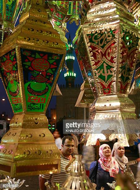 Egyptians shoppers look at 'Fanus Ramadan' a traditional lantern popular during the holy Muslim fasting month of Ramadan at a shop in elSayeda Zaynab...