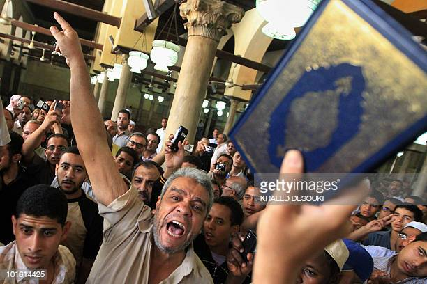 Egyptians shout antiIsraeli slogans and hold up the holy Quran after Friday prayers at AlAzhar mosque in Cairo on June 4 during a demonstration to...