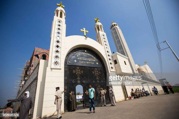 Egyptians stand outside the Coptic Orthodox Church of the Martyrs in the village of Al-Our in the southern Minya province on May 15 during the...