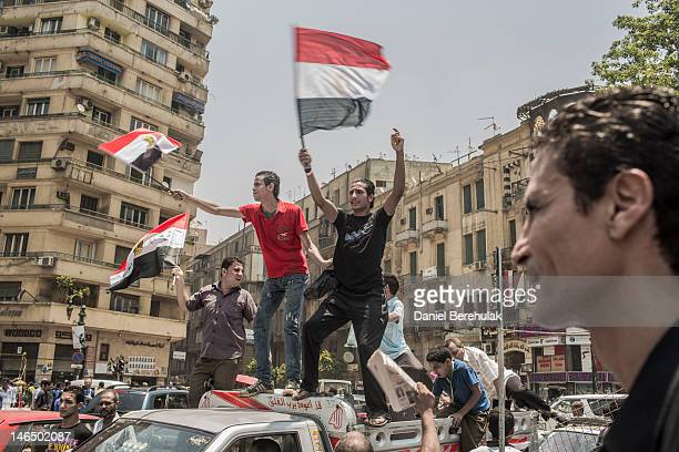 Egyptians supporters celebrate a premature victory for their presidential candidate Mohamed Morsi in Tahrir Square on June 18, 2012 in Cairo, Egypt....